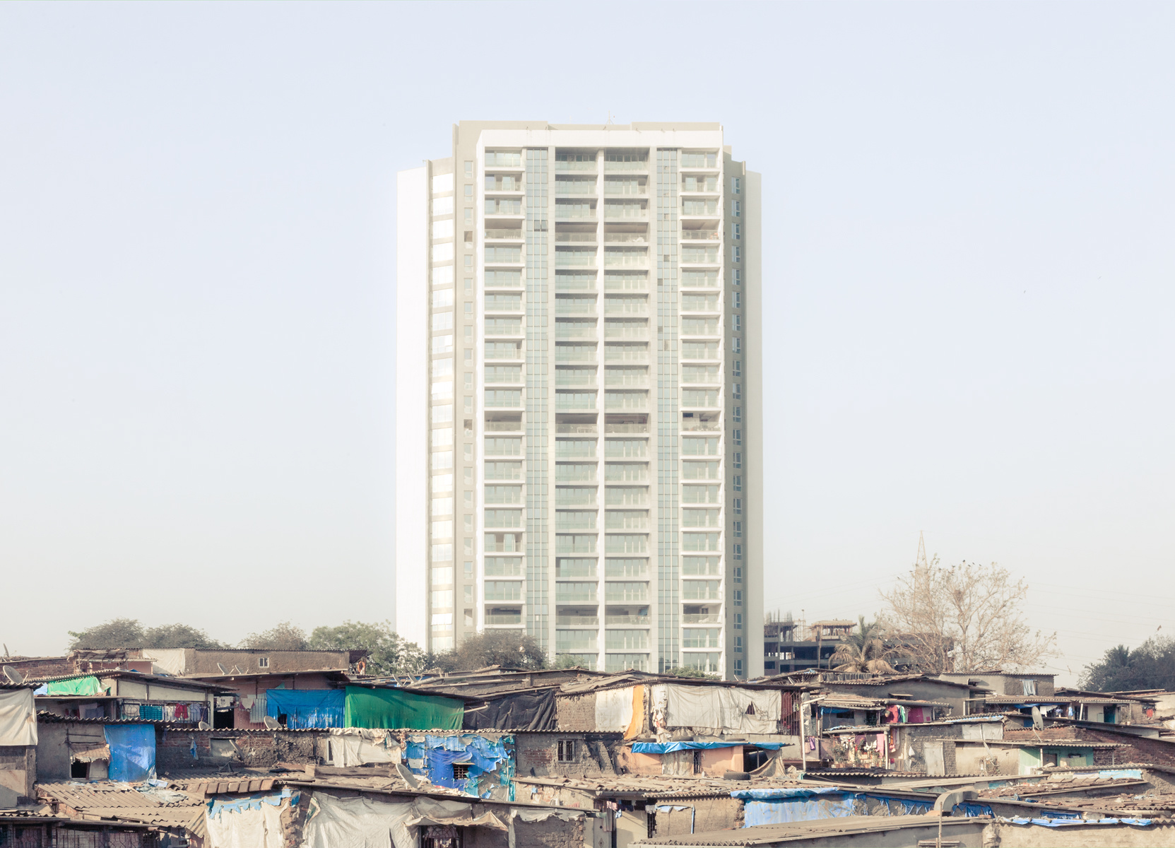 Slum and Luxury, slum redevelopment in Mumbai, Luxury apartments on slum land, Changing face of slums, Housing for slum dwellers, India real estate news, Indian property market news, Track2Media Research, Track2Realty